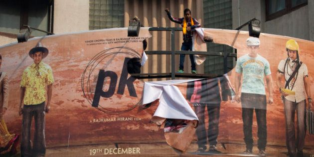 Hindu right-wing activists of the Hindu Sena tear a giant movie poster during a protest demanding a ban...