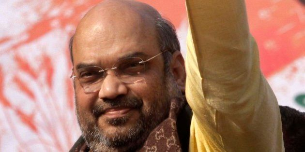 India's ruling Bharatiya Janata Party (BJP) president Amit Shah acknowledges the crowd during a public...