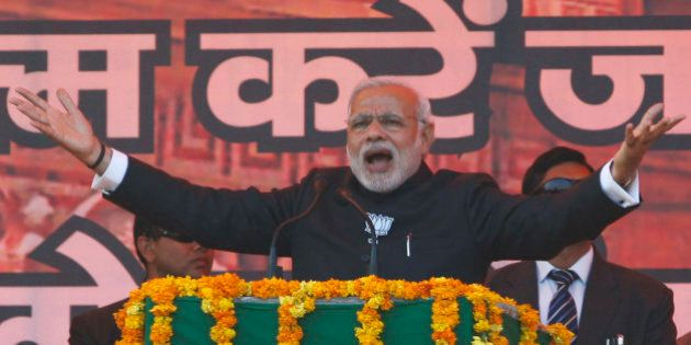 Indian Prime Minister Narendra Modi addresses an election campaign rally in Jammu, India, Tuesday, Dec....