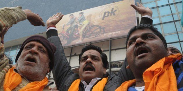 Activists from Shiv Sena, Sher-e-Punjab, shout slogans as they protest against the film 'PK' outside...