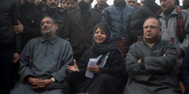 People's Democratic Party (PDP) leader Mehbooba Mufti, center, addresses the media at her residence in...