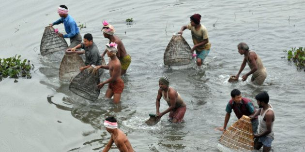 Tiwa tribe people participate in community fishing at the Jonbeel Mela on January 20, 2012. Hundreds...