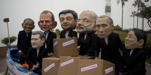 Activist depicting US President Barack Obama (L), Canada's Prime Minister Stephen Harper (2-L), Australia's...