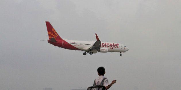 A SpiceJet Ltd. aircraft prepares to land at Chhatrapati Shivaji International Airport in Mumbai, India,...