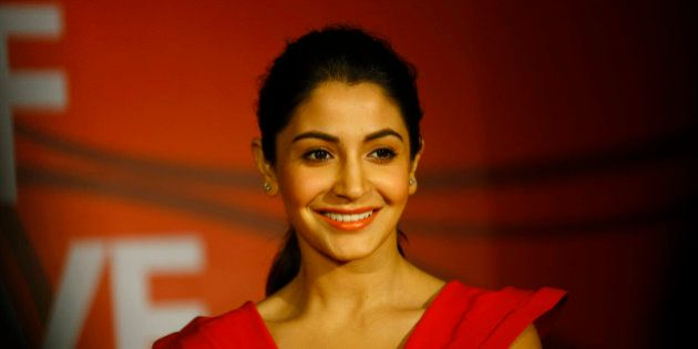 Bollywood actor Anushka Sharma smiles as she listens to a question from a journalist during a promotional...
