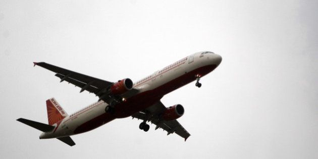 An Air India passenger jet approaches to land at Indira Gandhi International Airport in New Delhi, India,...