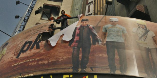 NEW DELHI, INDIA - DECEMBER 30: Poster of Aamir Khan-starrer film PK torn by activists of rightwing organizations...