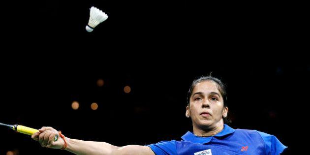 India's Saina Nehwal returns a shot to China's top seeded Li Xuerui, not seen, during their Quarter Final...