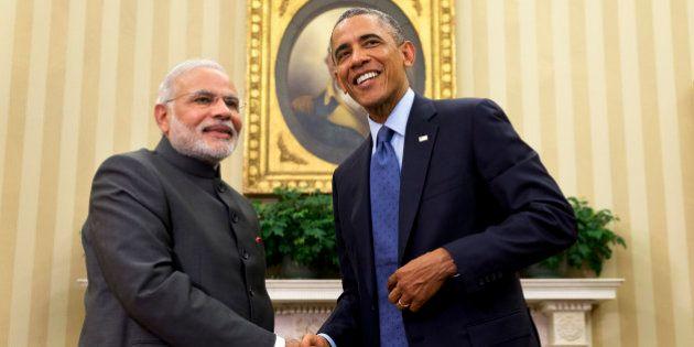 President Barack Obama shakes hands with Indian Prime Minister Narendra Modi, Tuesday, Sept. 30, 2014,...