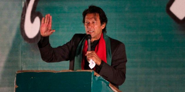 Pakistan's cricketer-turned-politician Imran Khan addresses his supporters during an anti-government...