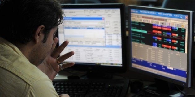 An Indian stockbroker watches his screen during intra-day trading at a brokerage house in Mumbai on September...