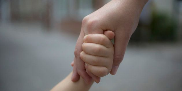 BERLIN, GERMANY - JULY 16: Child holding the hand of her mother on July 16, 2014, in Berlin, Germany....