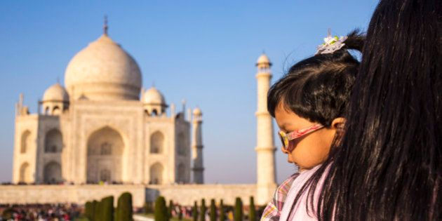 AGRA, INDIA - DECEMBER 01: Mother and her little daughter at the famous indian sightseeing point Taj...