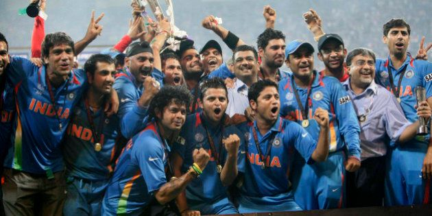 MUMBAI, INDIA - APRIL 02: Indian cricketers pose with the trophy after victory in the Cricket World Cup...