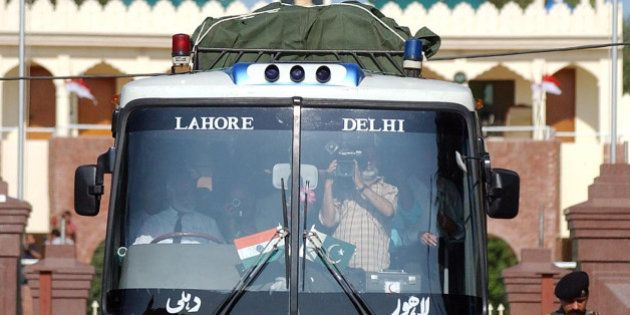 Indian Border Security Force officer Ish Aul, guides bus driver Aamir Khan, to the customs office after...