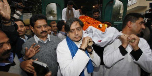 NEW DELHI, INDIA - JANUARY 18: Congress leader Shashi Tharoor (C) and relatives and friends carry the...