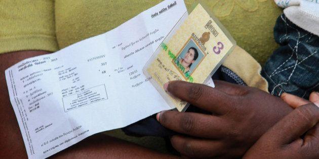MADAMULANA, SRI LANKA - JANUARY 08 : Sri Lankan people wait to cast their votes at a polling station...