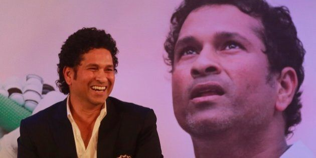 Retired cricket great Sachin Tendulkar smiles after launching his