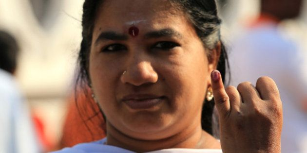 COLOMBO, SRI LANKA - JANUARY 08: A Sri Lankan minority ethnic Tamil woman shows her inked finger after...