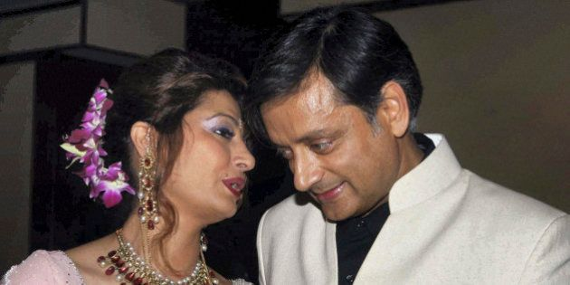 Former Indian Junior Foreign Minister Shashi Tharoor listens to his wife Sunanda Pushkar at their wedding...