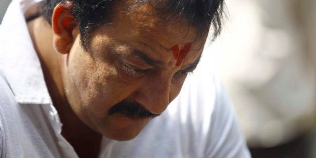Indian Bollywood actor Sanjay Dutt, looks down during a press conference at his residence in Mumbai,...