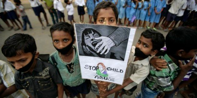 Indian children participate in a protest against child abuse and rising crimes against women, in Bhubaneswar,...