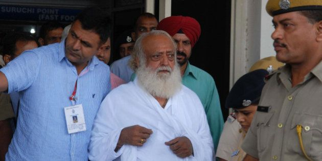 Indian spiritual guru Asaram Bapu (C) is escorted by police, after he was arrested from his Indore ashram,...
