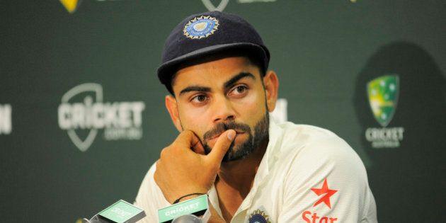 SYDNEY, AUSTRALIA - JANUARY 10: Virat Kohli of India looks on during day five of the Fourth Test match...