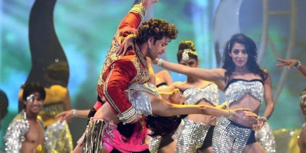Bollywood actor Hrithik Roshan performs on stage during the fourth and final day of the 15th International...