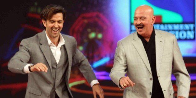 Indian Bollywood actor Hrithik Roshan (L) and his father Rakesh Roshan dance during the annual 'Umang...