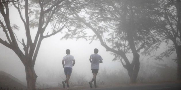 People jog on a foggy cold morning in Hyderabad, India, Sunday, Jan. 8, 2012. Though India is famous...