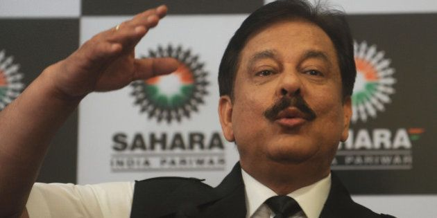 Subrato Roy, chairman of the Sahara Group gestures as he speaks during a news conference in Mumbai on...