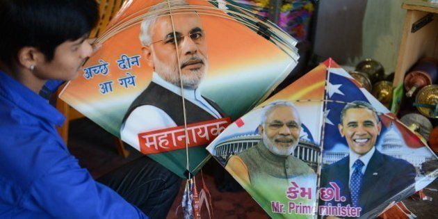 An Indian vendor displays kites printed with the portraits of Prime Minister Narendra Modi and US President...