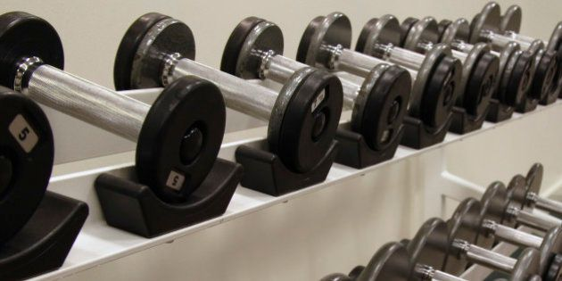 Two racks of free weights / dumbells at a health club. Canon