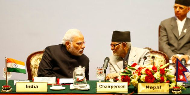 Indian Prime Minister Narendra Modi, left, speaks with Nepalese Prime Minister Sushil Koirala during...