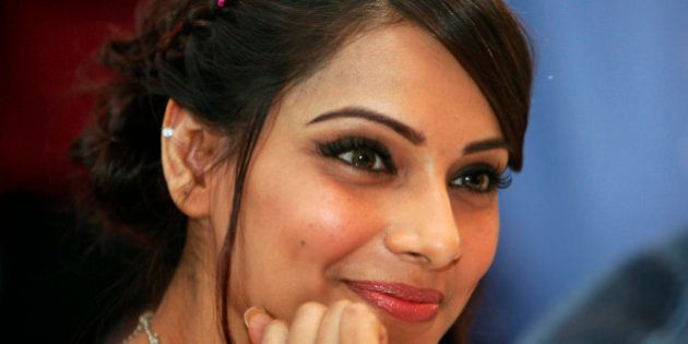 Bollywood actress Bipasha Basu smiles during a press conference to promote her