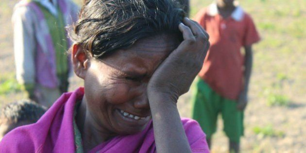 An Indian villager mourns the death of a relative in Phulbari in Sonitpur district, some 250kms east...