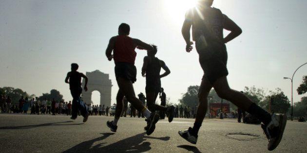 Athletes run during the Delhi half-marathon in New Delhi, India, Sunday, Oct. 16, 2005. Kenyas Phillip...