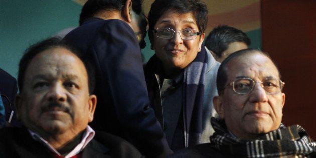 NEW DELHI, INDIA - JANUARY 16: Newly joined BJP leader Kiran Bedi with Delhi BJP President Satish Upadhyay,...