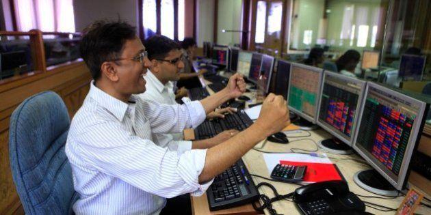 MUMBAI, INDIA - MAY 13: Stock traders rejoice the as Sensex rose to a third consecutive record high at...