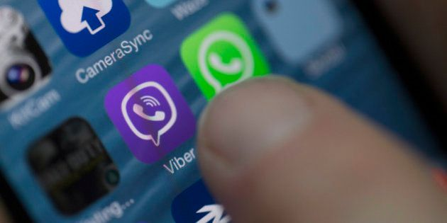 The Viber Internet messaging and calling service application is displayed on a smartphone in this arranged...