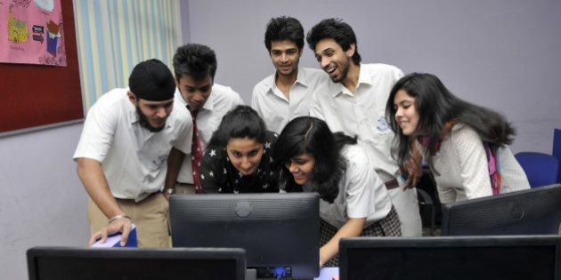 NOIDA, INDIA - MAY 29: Students checking their class XII board exams result on computer screen after...