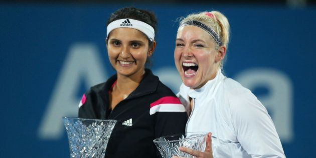 SYDNEY, AUSTRALIA - JANUARY 16: Bethanie Mattek-Sands of the USA and Sania Mirza of India pose with the...
