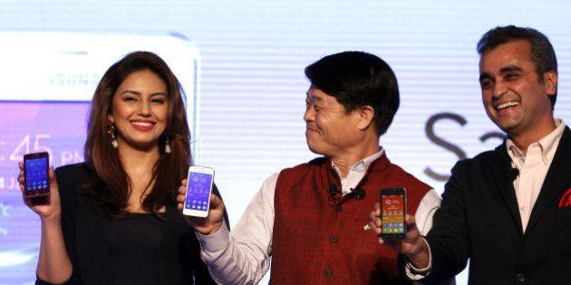NEW DELHI, INDIA - JANUARY 14: Actress Huma Qureshi with Samsung CEO Hyun Chil Hong and Vice -President...