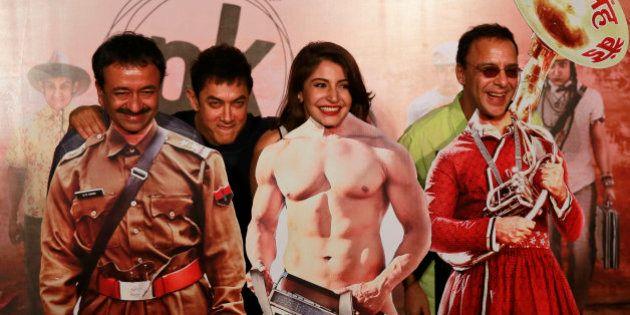 Bollywood Director Rajkumar Hirani, left, Bollywood actors Aamir Khan, second left, Anushka Sharma, second...
