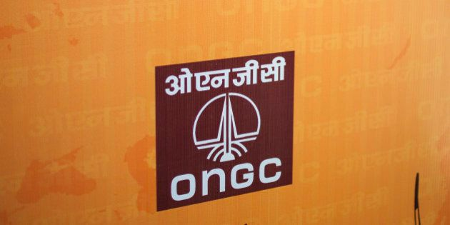 An attendee stands at the Oil & Natural Gas Corp. (ONGC) news conference in New Delhi, India, on Wednesday,...