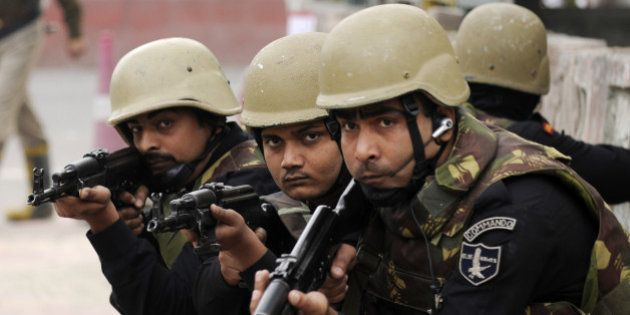 NOIDA, INDIA - JANUARY 21: Commandos take position during the mock drill conducted by Anti Terror Squad...