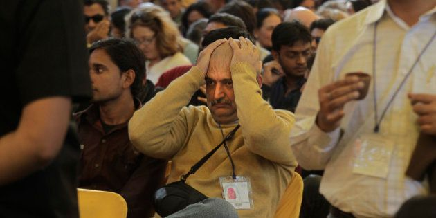 A visitor reacts when he hears the news of Indian born British author Salman Rushdie's video conference...