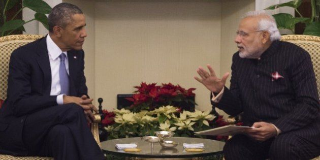 Indian Prime Minister Narendra Modi (R) and US President Barack Obama talk during a meeting at Hyderabad...