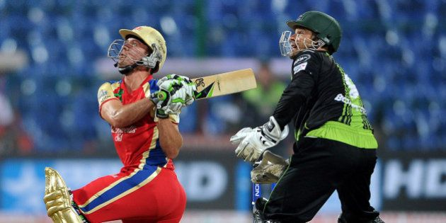 Royal Challengers Bangalore player AB De Villiers plays a shot against the Warrior's during the Champions...